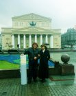 "Alexey Akindinov and Ruslana Andriyanova. Moscow, Theatre Square, on October 19, 2015. Nearby – a tube with a picture ""the Birth of the Titan.\"" Against the Bolshoi Theatre."