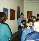 Alexey leads excursion on the exhibition in the State Museum of local lore, in Sasovo, Ryazan. 2003.