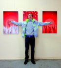 Artist Alexander Suhanov near his work