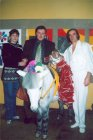 Alexey at the circus. From left to right: Lena, Alexey, burro and marmoset and air gymnast Valeriy Panushkin. 2003.